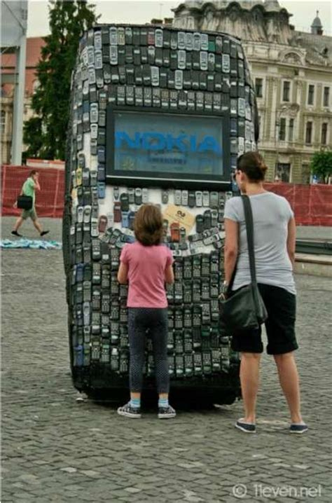 Recycled Gadget Statues : giant cell phone sculpture