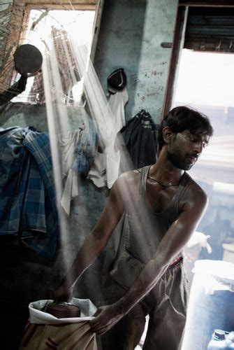 In Indian Slum, Misery, Work, Politics and Hope - The New