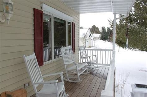 Keep our beige siding, add some shutters (different color