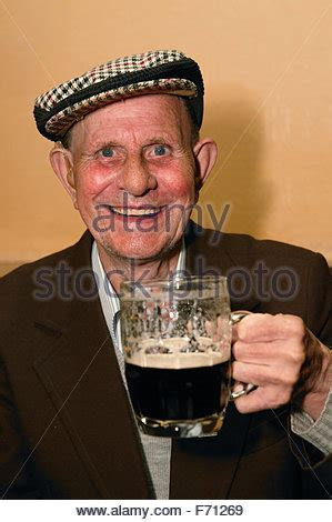 Old man drink a Guinness Stock Photo: 15439387 - Alamy